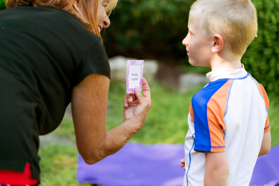 Joanie presenting Laughter Yoga Card to young boy